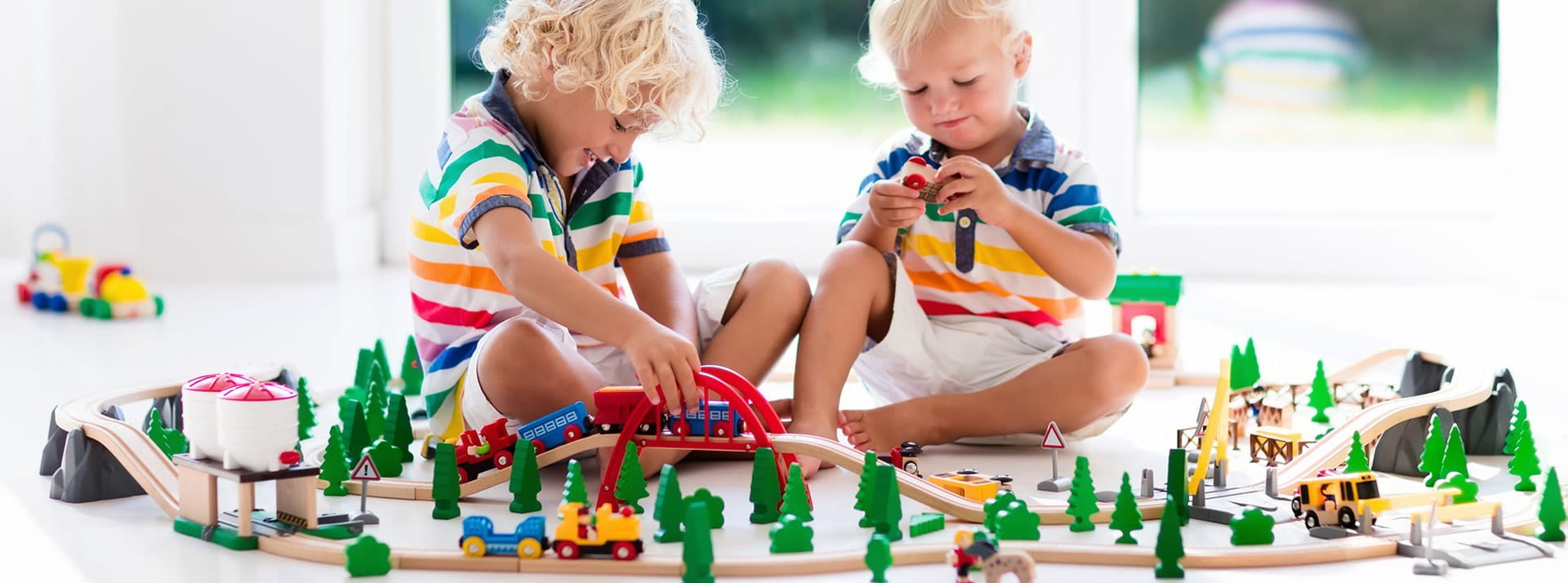 children playing with wooden railway